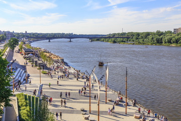Warsaw, section of Vistula boulevards between  Swietokrzyski Bridge and  Silesian-Dabrowski Bridge. Sundey afternoon.