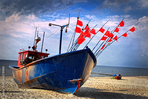 Poster Fishing boat on the beach