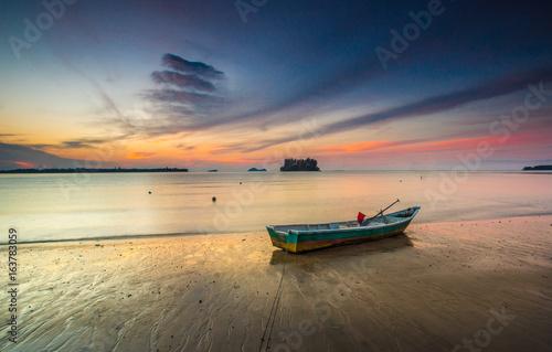 wonderful sunset with fishing boat at pandak village,kuching sarawak on 4 may 2017
