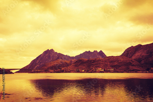 Mountains by the sea at sunset. The beautiful nature of Norway