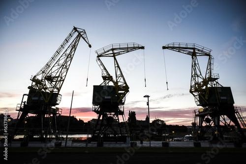 Old cranes in Szczecin by sunset. Szczecin, Poland.