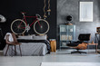 Bedroom with bicycle - 163806421
