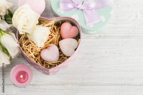 Arrangement of eustoma flowers in pot, pastel gift box © Irina Bort