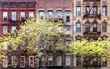 Historic old buildings and trees along 3rd Avenue in the East Village of Manhattan, New York City