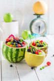 Fresh fruits salad in pineapple, melon and watermelon - 163811004