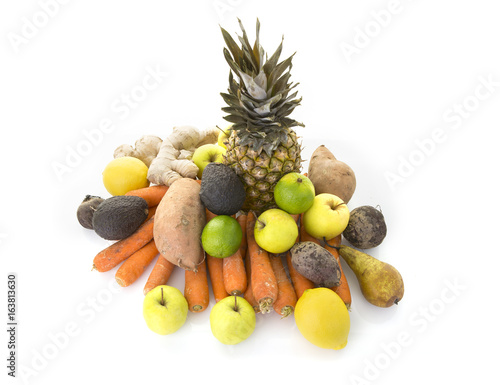 A pile of healthy fresh organic fruit and veg on a white background