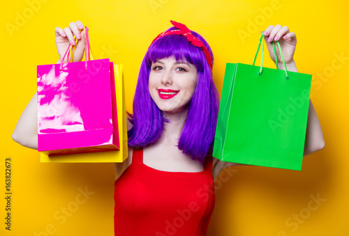girl with purple color hair and shopping bags