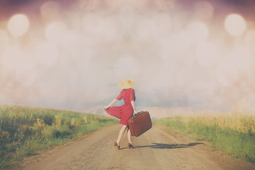woman with suitcase on the road