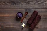 Lavender bath salt on wooden table background top view copyspace