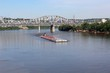 The barge headed up river on the boarders of Kentucky and Ohio.