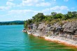 Lake Travis in Texas has some incredible cliffs on the edge of the lake to climb or jump into the water from.