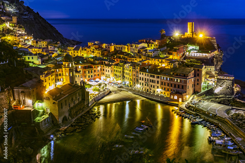 Italy. Cinque Terre (UNESCO World Heritage Site since 1997). Vernazza town by night (Liguria region)