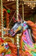 carousel merry-go-round painted horses ride - Stock Photo