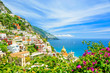 Quadro beautiful view on Positano on Amalfi coast with blurred flowers on foreground