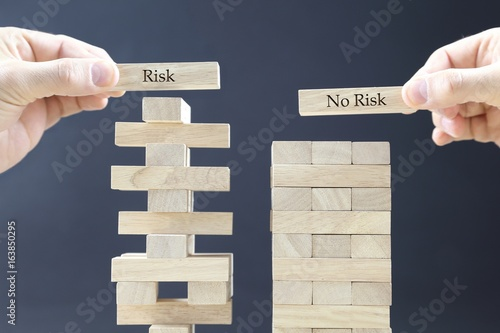 business concept with wooden blocks: risk - no risk - 163850295