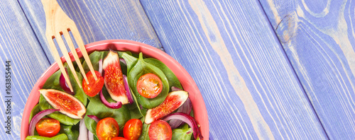 Fresh fruit and vegetable salad with fork, concept of healthy food and nutrition, copy space for text on boards