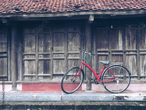 Old bicycle park with old house