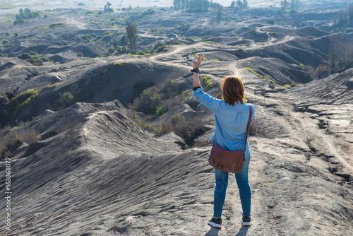Woman on top of Layer Volcanic ash as sand ground of Mount Bromo volcano (Gunung Bromo) at Bromo Tengger Semeru National Park, East Java, Indonesia
