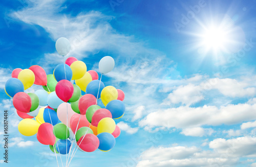 Happiness, summer, wedding, birthday, honeymoon party: Multicolor ballons, blue sky, clouds and sun :) - 163874414