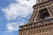 close up o Eiffel tower against blue sky with clouds