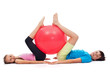 Young boy and girl exercising with a large gymnastic rubber ball - 163900011