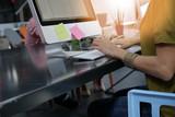 Closeup of office-worker typing on desktop keyboard