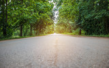 Landscape of road around the tunnel trees in countryside green forest, nature street of Thailand