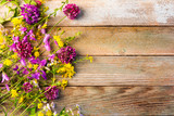 wildflowers on a wooden rustic vintage background with space for text - 163918809