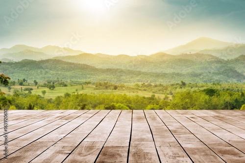 wooden table top with the mountain landscape - 163920610