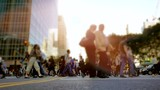 crowd of people walking in the city commuting through business district - 163930662