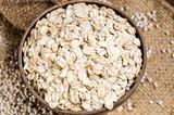 barley flakes and pearl barley in sack bag - 163933414