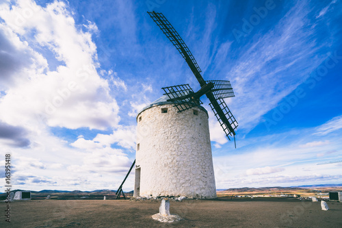 The windmill against the cloudy sky Canvas