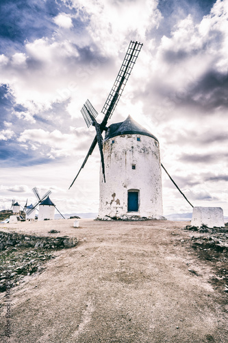 The windmill against the cloudy sky Poster