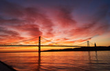 clouds on fire on a sunrise in Lisbon, Portugal, with the April 25th Bridge