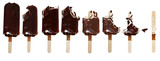 Progression of chocolate covered vanilla ice cream bars on a wooden stick with bites taken out. Isolated over a white background. - 163968661