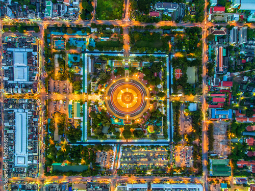 Aerial view Road roundabout with car lots in Thailand.Beautiful street.The light on the road at night and the city in Thailand.Lights of cars on the road.Phra Pathom Chedi.