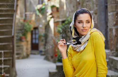 Tourists in a shawl on the streets of a small Italian town