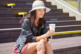 Hipster woman during coffee break on street