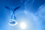 Angel sculpture over bright sky - 164031493
