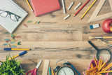 Fototapety Wooden desk with supplies
