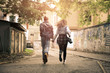 Couple holding hands outdoors. Young couple running trough  street. - 164049448