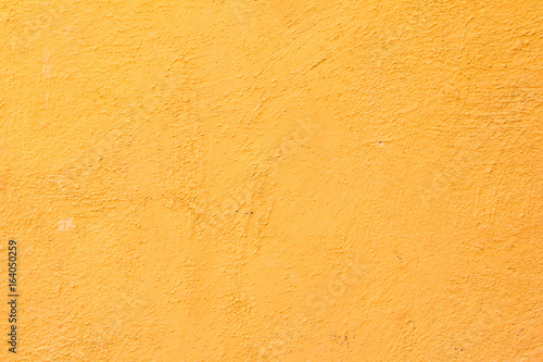 Orange color concrete wall background