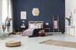 Dark blue wall in bedroom - 164061670