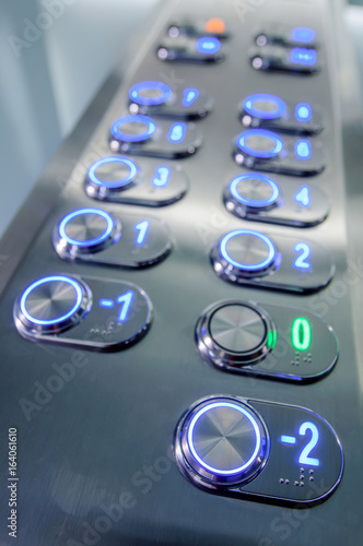 Elevator buttons inside elevator cabin pressing buttons - 164061610
