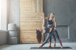 Young woman with yoga instructor in fitness class, triangle pose