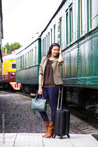 beautiful middle-aged woman with luggage Poster