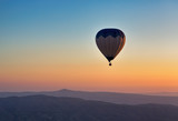 Hot air balloon flight at sunrise. - 164064222