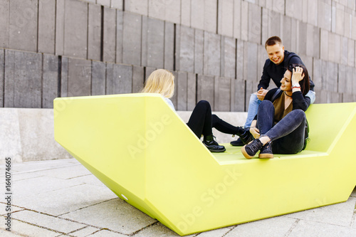Young people sitting on the bench in Vienna, Austria
