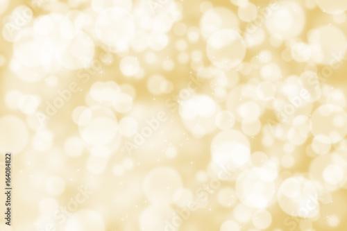 Abstrakcjonistyczny ilustracyjny bokeh światło na złotym tle