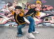 Two brothers dancing break dance.Hip-hop style.The cool kids.Graffiti on the walls.